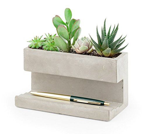 - Go green at the office - Desktop planter is made of solid concrete - The terraced base holds pens, business cards, or other small supplies - Great accent to any desk - Measures 6.3 by 3.6 by 3.2-inc