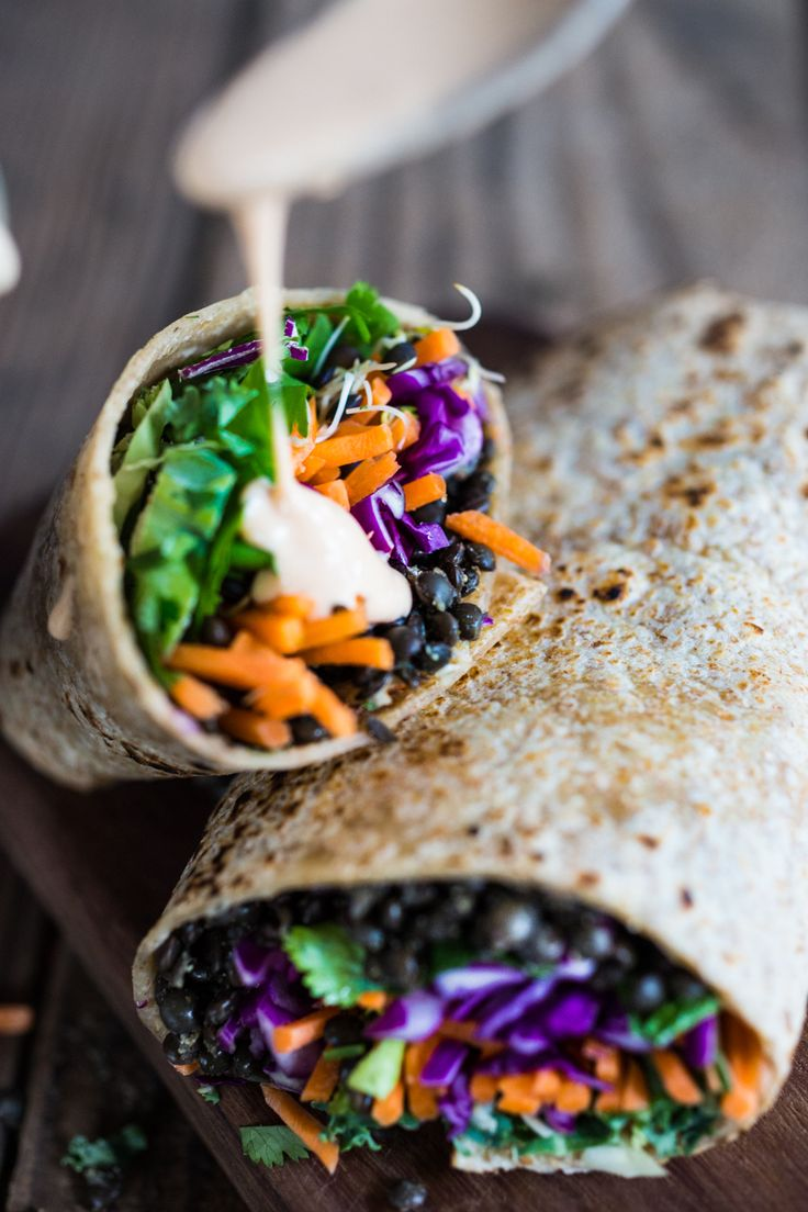 Spicy Lentil Wraps with fresh veggies and Sriracha spiked  Tahini Sauce | www.feastingathome.com... Use GF wraps...