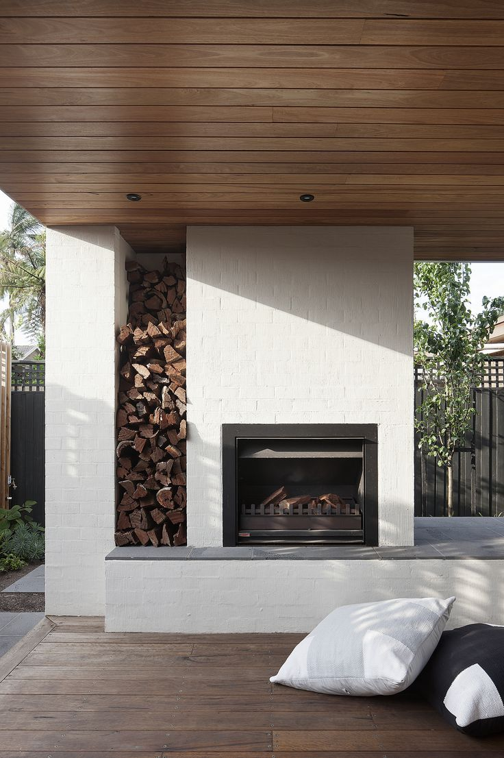 An outdoor fireplace with built-in firewood storage. When Stephen Mendel—co-owner of Australian furniture company Globe West—and his wife bought a rundown 1960s house in the Melbourne suburb of Caulfield, the design-savvy pair knew what they wanted. Experienced remodelers, they had previously worked with Bower Architecture, and turned to the designers to bring their program to life once again.