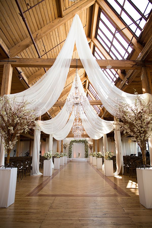 Epic Rustic Glam Wedding in Chicago... draping fabric for barn, rafters & ceiling.