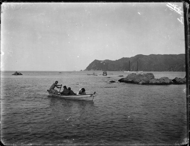 Waipiro Bay, Gisborne region, with Maori group in a fishing boat. Hargreaves, Frederick Ashby.