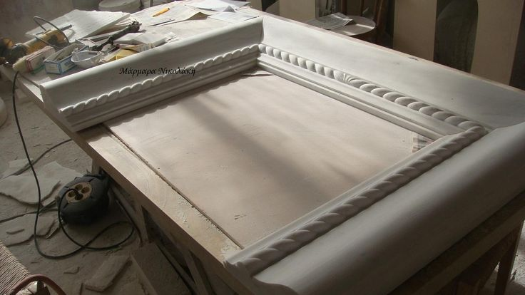 Fireplaces Greek Dionyssos marble (patinated). Contact: sales@marmara.gr