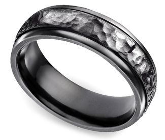 Men's wedding ring. Black hammered Titanium. Looks cool and you don't have to worry about it getting damaged.