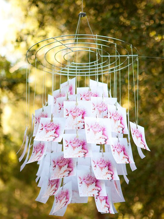 outdoor party decoration - photo chandelier -  photos of flowers ,print multiple copies, and clip them to the mobile frame.