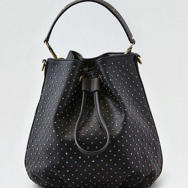 AE Bucket Bag ($40) ❤ liked on Polyvore featuring bags, handbags, shoulder bags, black, american eagle outfitters purses, bucket bags, american eagle outfitters, studded shoulder bag and long strap handbags