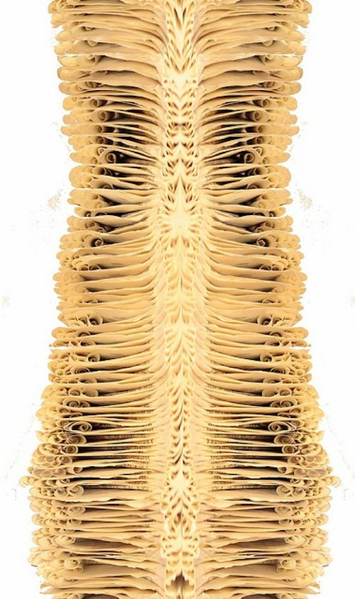 """""""Body Parts, Live Breath Art is a series of sculptures in which the artist took pages and pages of recycled books and transformed them into spiraling, abstract impressions of body parts."""""""