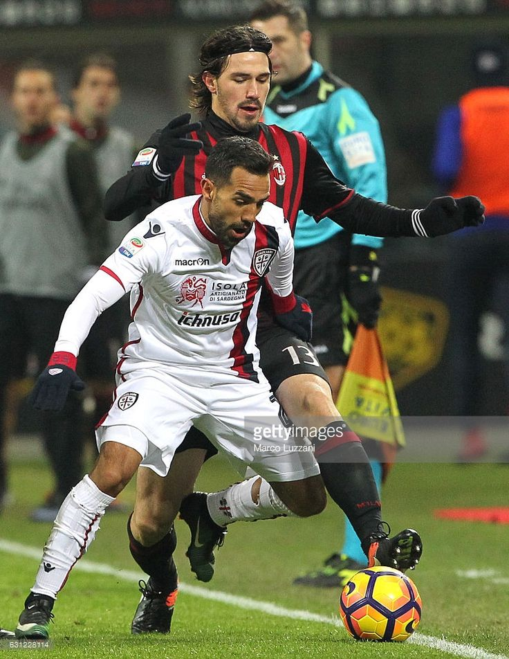 Marco Sau of Cagliari Calcio competes for the ball with Alessio Romagnoli (back) of AC Milan during the Serie A match between AC Milan and Cagliari Calcio at Stadio Giuseppe Meazza on January 8, 2017 in Milan, Italy.