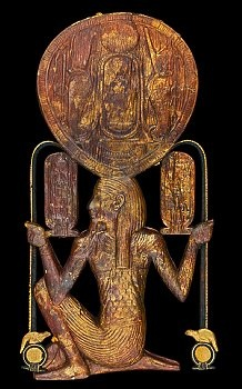 Gilded Wood & Gold Leaf Mirror case w/ god Heh: Tomb of Tutankhamun.  The mirror case takes the form of the god Heh holding notched palm ribs resting on tadpoles & shen rings. hanging from the ends of the palm ribs are cartouches with the names of the king.  Above the king's head, which would have protected the disk of the mirror, is carved the king's throne name. Cairo Museum