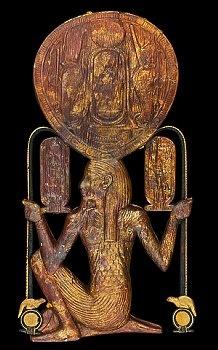 Espejo adornado con el dios Heh de la tumba del faraón Tutankhamón.