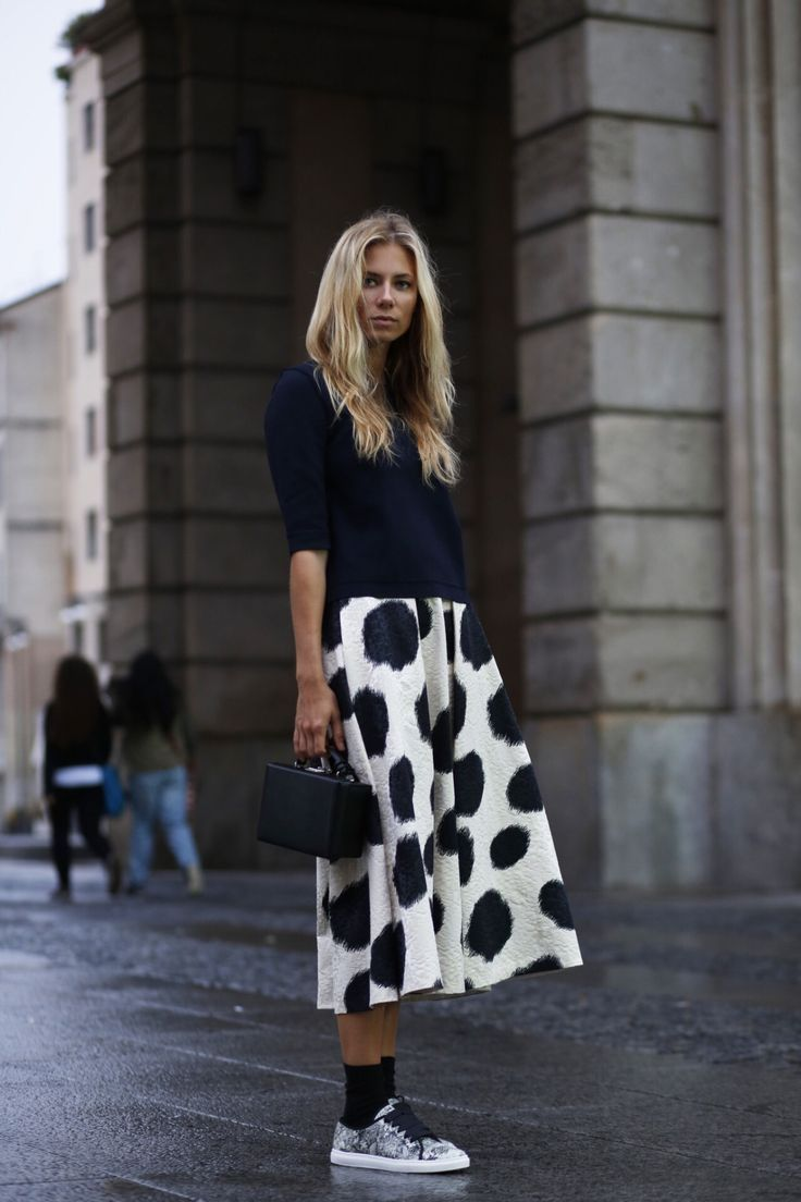 The perfect combination; printed skirts, long sock and patterned trainers.