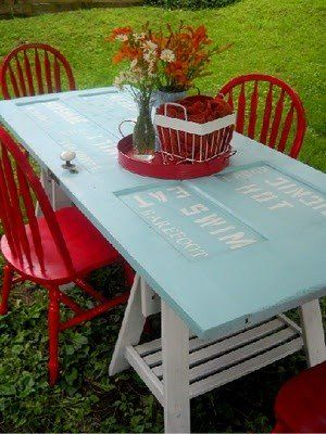 Transform an old door into a colorful table to brighten up your yard and add summer seating. #Door, #Garden, #Table