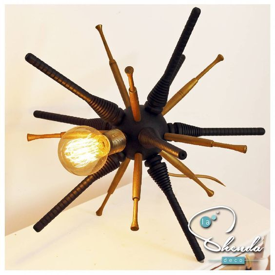 Sputnik Black&Gold spider lamp by La Shenda Deco  #lashendadeco #lampara #lamps #upcycledart Lamp created with upcycled spindles. It can be custom made in any colour combo. #sputnik #spiderlamp #upcyclinginteriors #handcraftedlamps #woodenlamp #eclecticdecor #edisonbulbs #eclecticinteriors #interiordesign #recycledwood #ilovemyinterior #madeinbcn #interior2you #sputniklamp #uniquedesign #unusual #interiorismo #interiorinspo #blackandgold #syfy #lighting #vintage #interiors #retro…