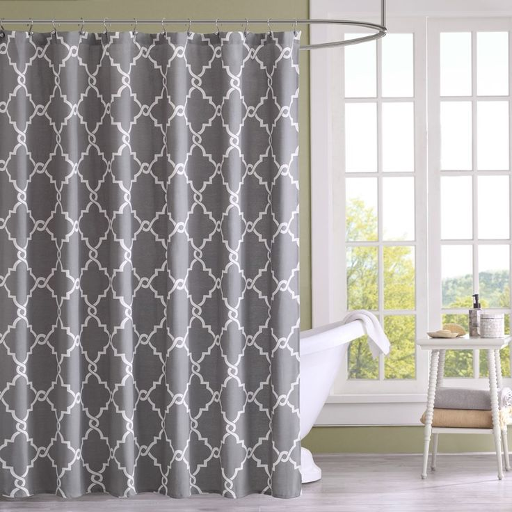 Refresh your bathroom with the decorative fretwork shower curtain. The scroll geometric print is simple, yet trendy with a light, poly/cotton basketweave fabric that softly filters light. The soft gre