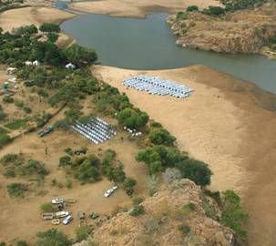 Aerial view of Maramani Camp, Matabeleland, Zimbabwe - in previous years the camp was situated in the dry river bed but flooding earlier in January has left large pools of water. And an abundance of crocodiles!