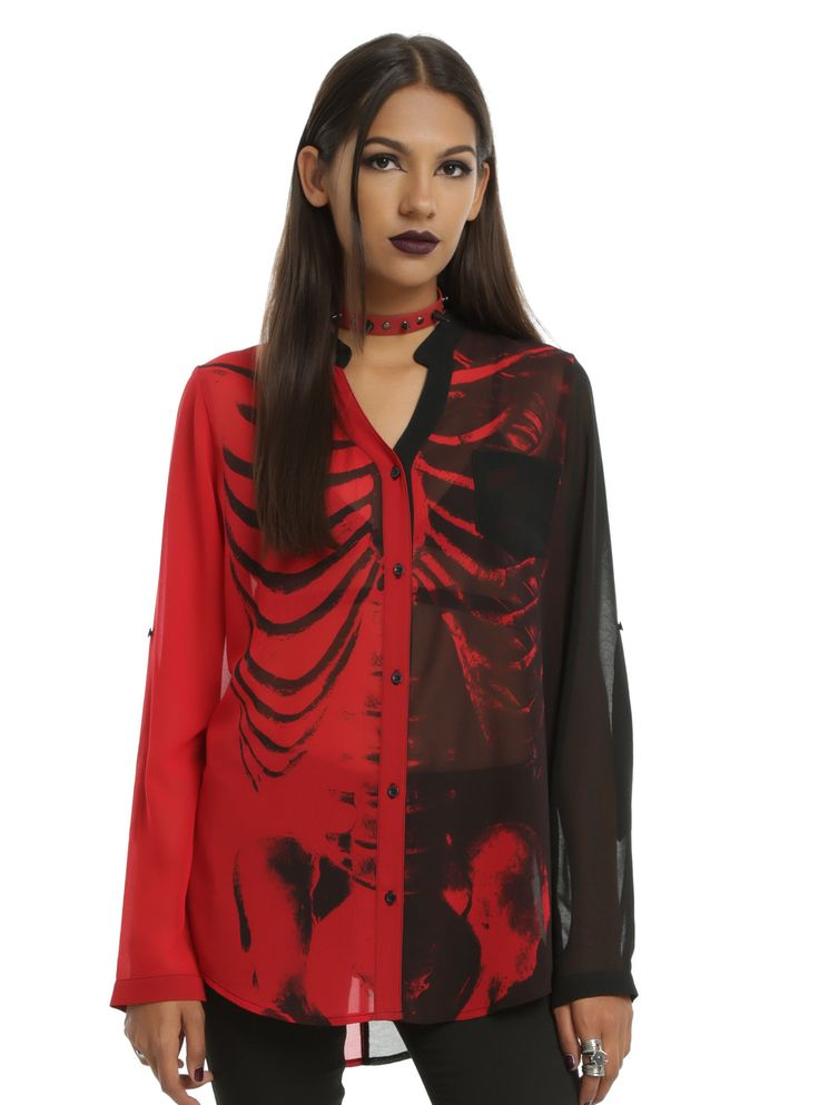 <p>Iron Fist and Ash Costello from the band New Years Day have done it again! They've collaborated to make an amazing line worthy of Bat Royalty. This sheer chiffon top is the best color combo ever - black and red. The split shirt is reminiscent of a jester with an X-ray style skeleton print in each side's opposing color. A V-neck collarless button down front, black sheer left breast pocket and convertible sleeves with roll tabs finish out the details on this shirt fit for the ...