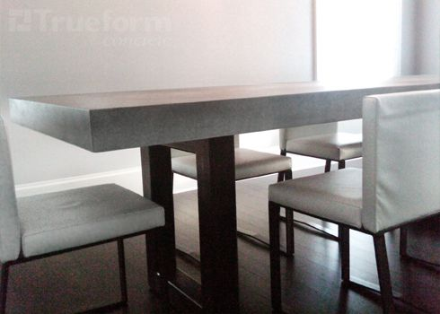 Modern dining table with a concrete countertop and a steel for Concrete kitchen table