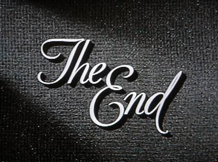 Classic image of text we would see in old films. The text and the backdrop itself connote a sense of an end to something. Perhaps its the black backdrop and the little flicker of light on the text.