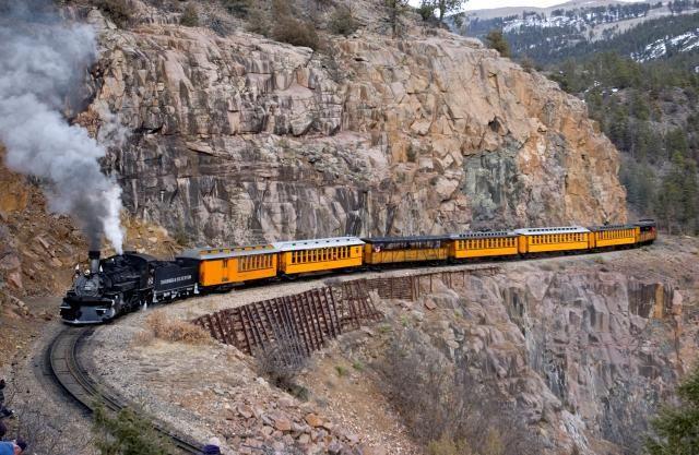 The Durango & Silverton Narrow Gauge Railroad hugs a mountainside curve - Durango, CO and Silverton, CO