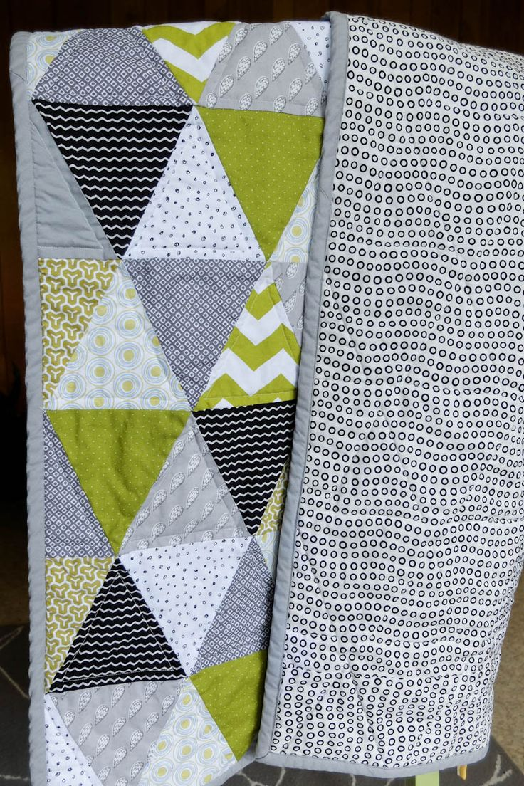 I have three different quilts going on at the same time, but here's the first one completely finished! I love that it's mostly grey, black and white with a pop of green. It's perfect for a baby boy or girl and can be used as a playtime quilt. It's even a great size to use …