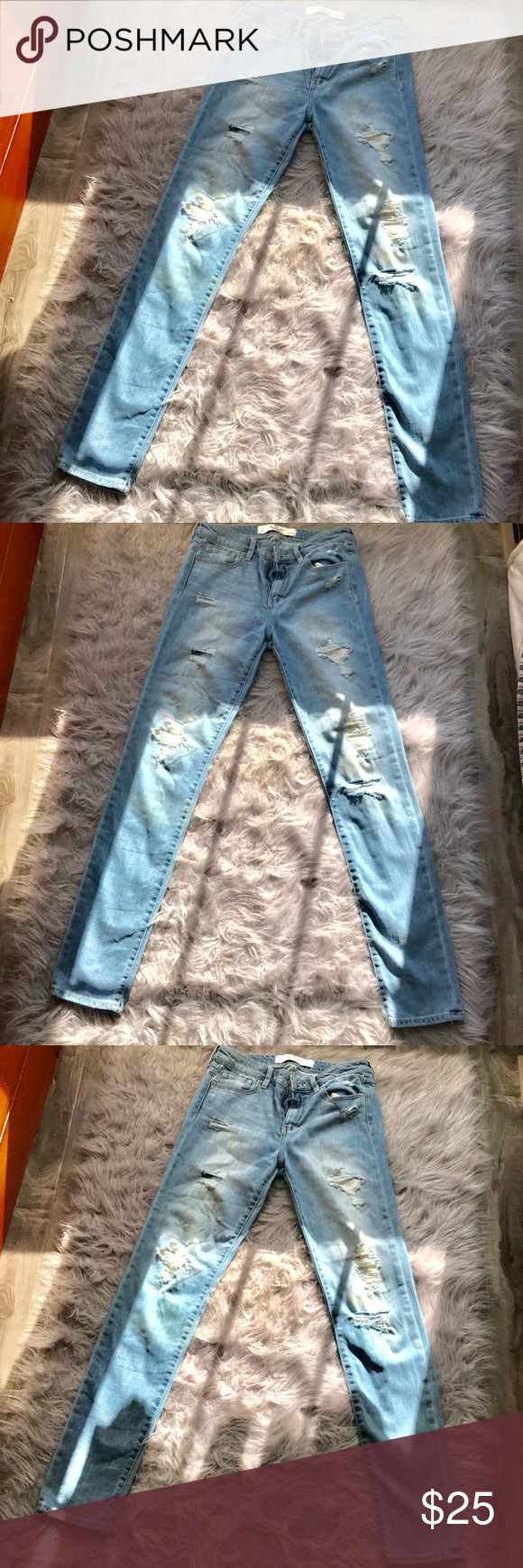 """Abercrombie and Fitch jeans Destroyed denim skinny jeans by a&f with beaded designs inside ripped area of jeans. Length of jeans is 41"""", inseam is 30.5,"""" waist is 27"""" Abercrombie & Fitch Jeans Skinny"""