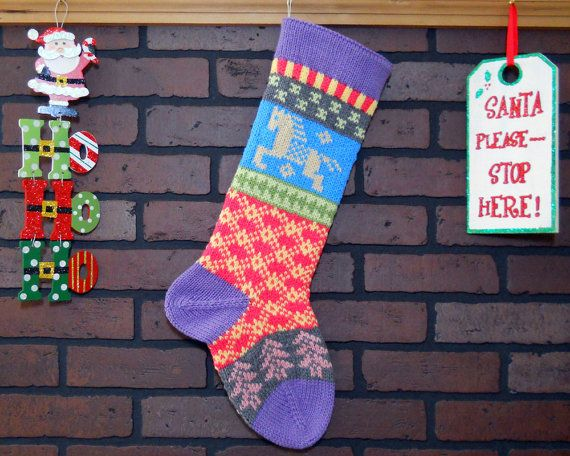 Hang this charming Christmas stocking by the fireplace this Christmas. I knit the cuff, heel and toe in a beautiful Lavender color. I also