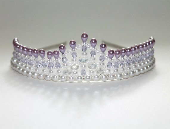 This tiara measures 1.5 inch or 4 cm at its highest peak and is adorned with lovely lilac purple drops and light purple crystals. This tiara is