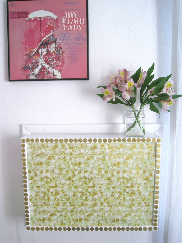 Create an adorable cover for an ugly in-wall air conditioner. So need to do this for when the weather cools down.