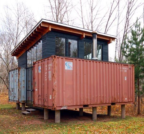 """…a pair of sea-shipping containers radically converted into a single on-land dwelling. A local train yard and a few hundred dollars can buy..."