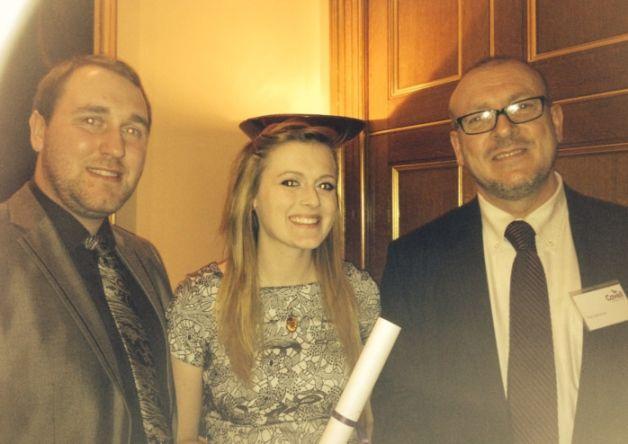 Emily Gartshore with her nursing award, boyfriend Steve and dad Paul