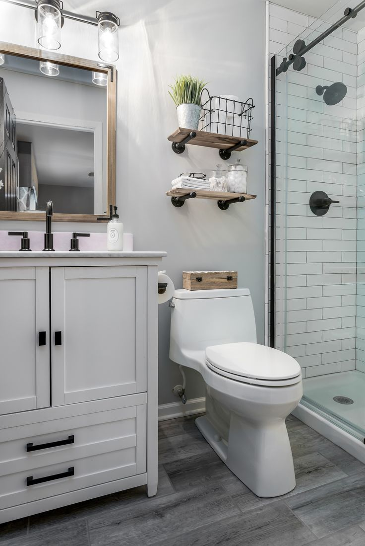 In this modest-sized master bathroom, modern and farmhouse ...