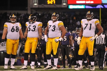 BALTIMORE, MD - DECEMBER 05:  Chris Kemoeatu #68, Maurkice Pouncey #53, Ramon Foster #73 and Flozell Adams #71 of the Pittsburgh Steelers look on during the game against the Baltimore Ravens at M Bank Stadium on December 5, 2010 in Baltimore, Maryland.