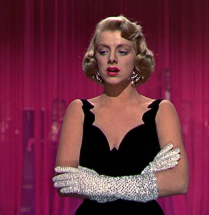 "Rosemary Clooney, ""White Christmas""...I know someone who just loves this movie 'cause of her...and the dress...!  That would be me...also love the green dress at the party!!"