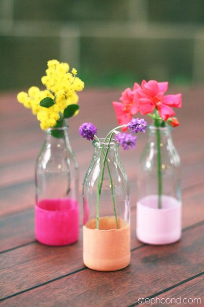 Mini milk bottles or juice bottle dip-dyed and used as bud vases. Tutorial and other dipping ideas at link.
