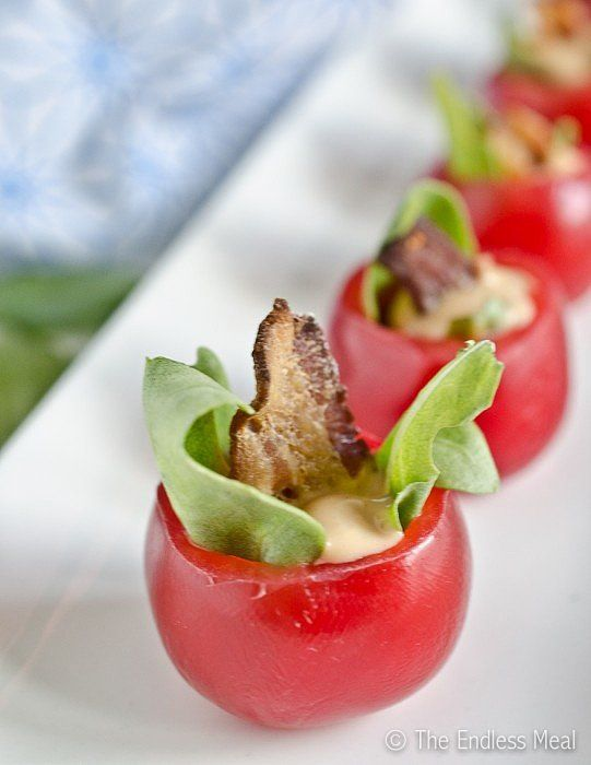 How adorable are these mini BLT cups? I'm obsessed! Made with a grape tomato, a small piece of crispy bacon, lettuce, and some chipotle aioli . . . I can totally see these being the first snack to go at any occasion.  Source: The Endless Meal