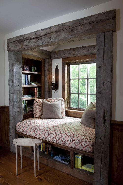 reading nook. LOVE - I could see creating this in a room by flanking the window in bookshelfs/cabinets to give you this sweet spot - as my house has none! :)