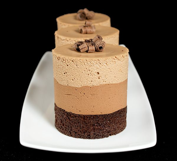 Impress guests with individual Triple Chocolate Mousse Cakes, perfect for entertaining. Find recipe for Triple Chocolate Mousse Cakes at Grace's Sweet Life.