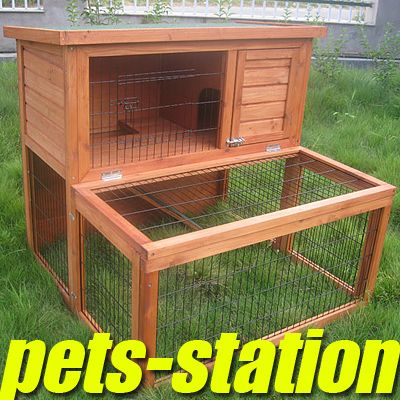 new {larger} hutch for the guinea pigs