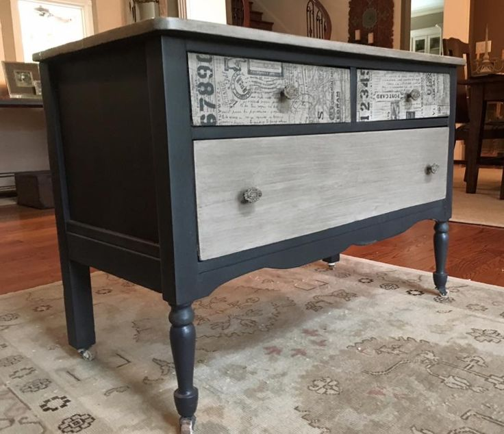 Dark grey with custom coco/old white an antiquing glaze on drawer fronts and top. Top drawers have antiqued artisan paper découpaged..