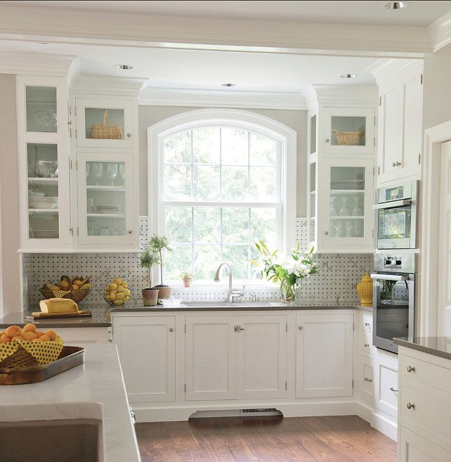 love the mix of glass doors and solids and the clean, but charming classic style of the cabinets.