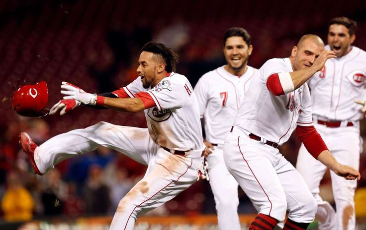 May 1: Reds center fielder Billy Hamilton (left) and first baseman Joey Votto (19) celebrate after Hamilton hit the game winning double against the Pittsburgh Pirates during the 10th inning at Great American Ball Park. Mandatory Credit: David Kohl-USA TODAY Sports