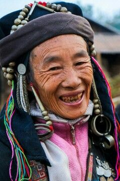 A cheeky grandma in Akha finery in her village near Phongsali, Laos.