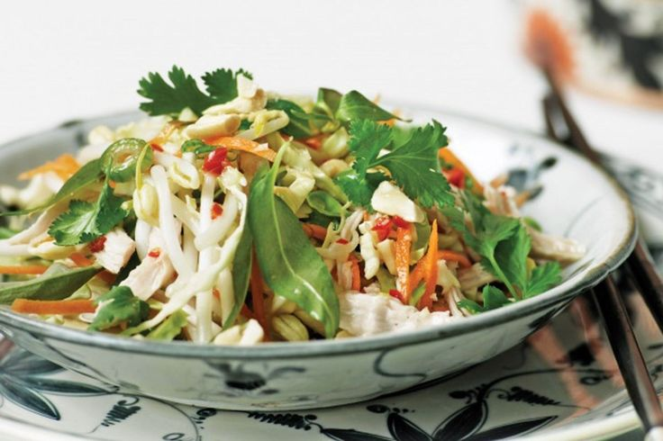 """This is a classic chicken salad found in virtually every Vietnamese restaurant in France. What appeals to me is the combination of lightly poached chicken, bean sprouts, spring onions and herbs with roasted chopped nuts and sesame seeds, together with the slightly gloopy fish sauce, lime juice and chilli dressing."" - Rick Stein"