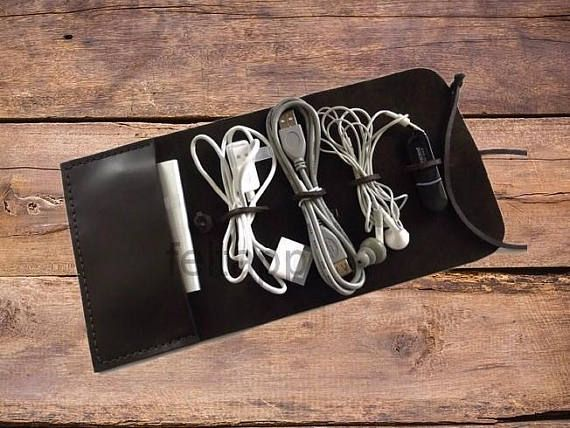Leather Cord Wrap with Pocket, Leather Cable Organizer, Cord Roll, Cord Organizer, Brown or Black Color, Hand Stitched This cord wrap holds 4 cables and plugs. A stilish way to wrap your USB cords, earbuds, plugs and go. Made from premium Italian leather. Available in Brown or Black