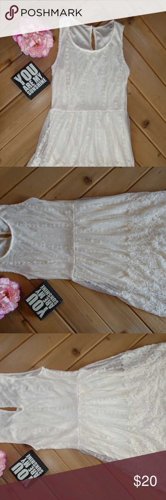 Dress This is an ivory colored dress from Charming Charlie's. This dress is perfect for a nice date or Easter Sunday. Charming Charlie Dresses