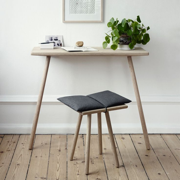 Skagerak Georg Console Table - Oak. The Georg oak console table by Christina Liljenberg Halstrøm, was inspired by the need for a place to drop keys and other things off in narrow spaces such as hallways and living rooms.