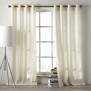 I've heard these are good for sound dampening and insulation. They look like they'll allow light, too. Velvet Grommet Curtain - Ivory | West Elm