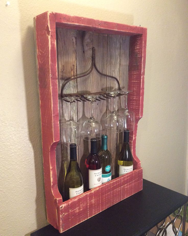 Rustic wine rack from pallet wood and fence pickets with rusty rake head.  $115 on Etsy, shipping included.