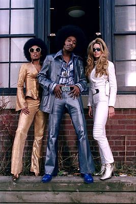 Undercover Brother (Eddie Griffin) with his two fine bookends (Denise ...