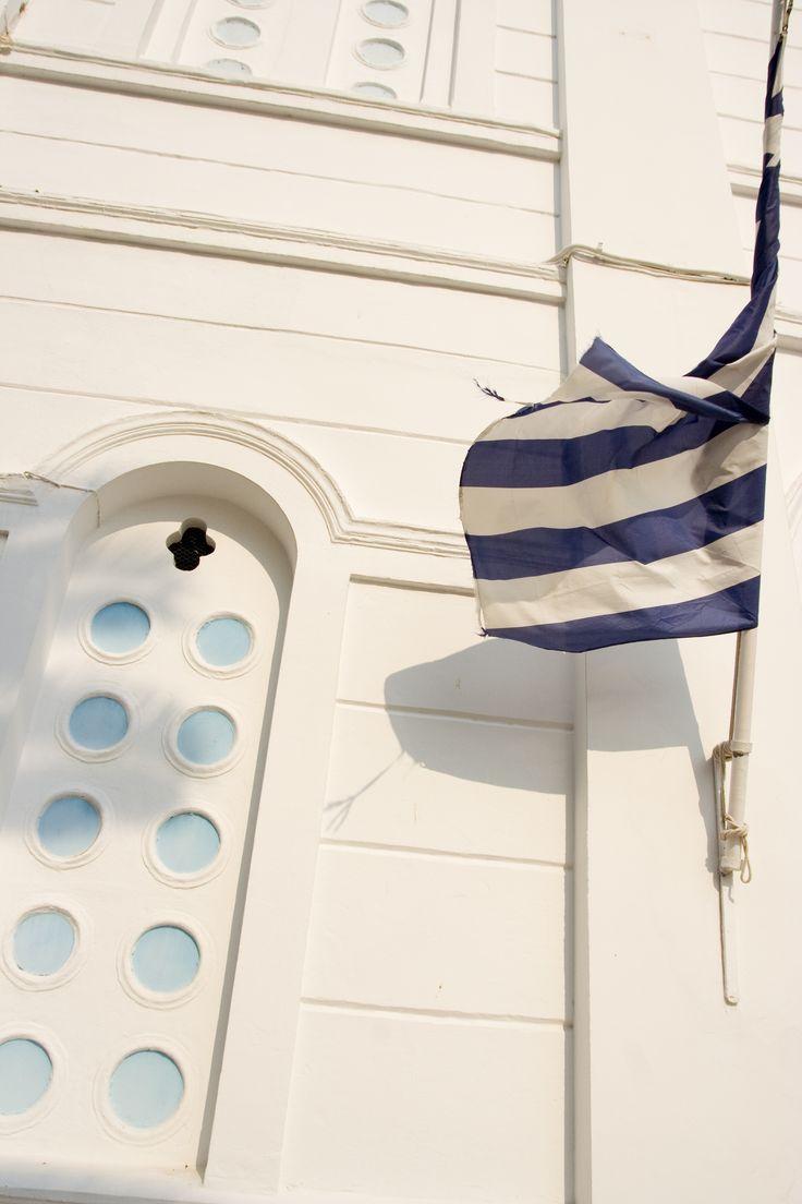 Greek Flag on orthodox church, Nafplio, Greece