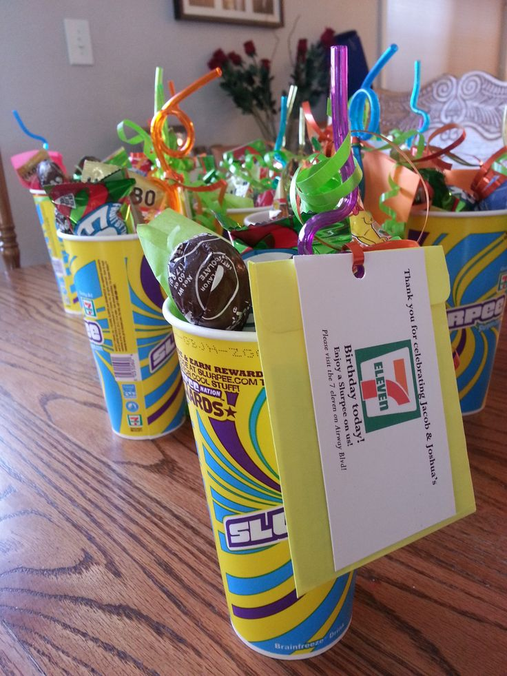 """My boys turned 7 and 11 years old and their birthdays are very close together. For their combined birthday party favor I made these for the guests. """"Thank you for celebrating our 7 eleven birthday today"""" Enjoy a slurpee on us! $2 in the envelope behind the card. It's better than all the plastic junk they usually get.  Filled the slurpee cups with some candy, silly straw and tissue paper."""
